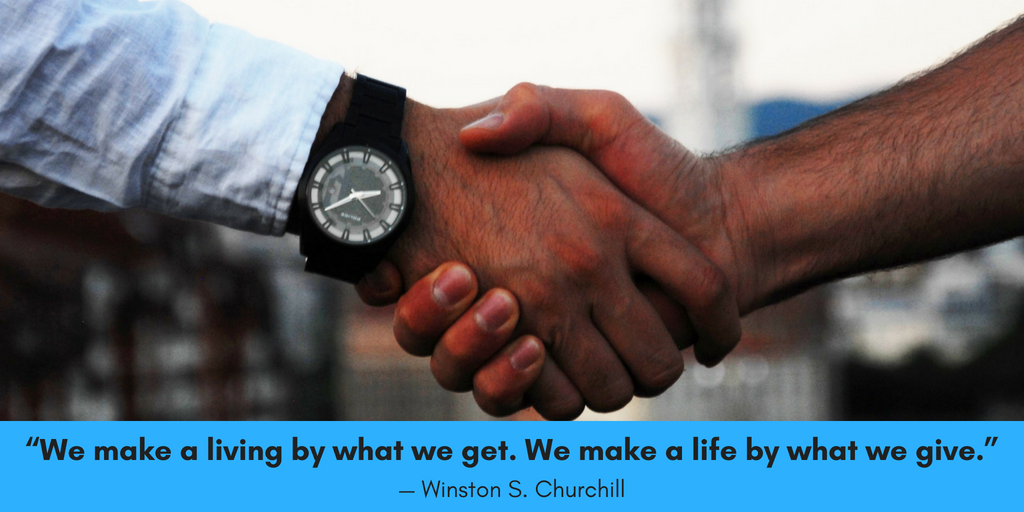 "The image of two people shaking hands followed by a quote by Winston Churchill saying, ""We make a living by what we get, but we make a life by what we give."" This photo is for a blog post talking about in-kind contributions and how they are different from other types of nonprofit donations by companies and individuals."