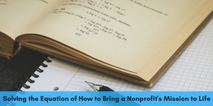 An image of a textbook with a math equation and pen and paper illustrate the topic of this Dreamscape Foundation blog, which is an interview with Matthew Hale about solving the equation behind nonprofits' success.