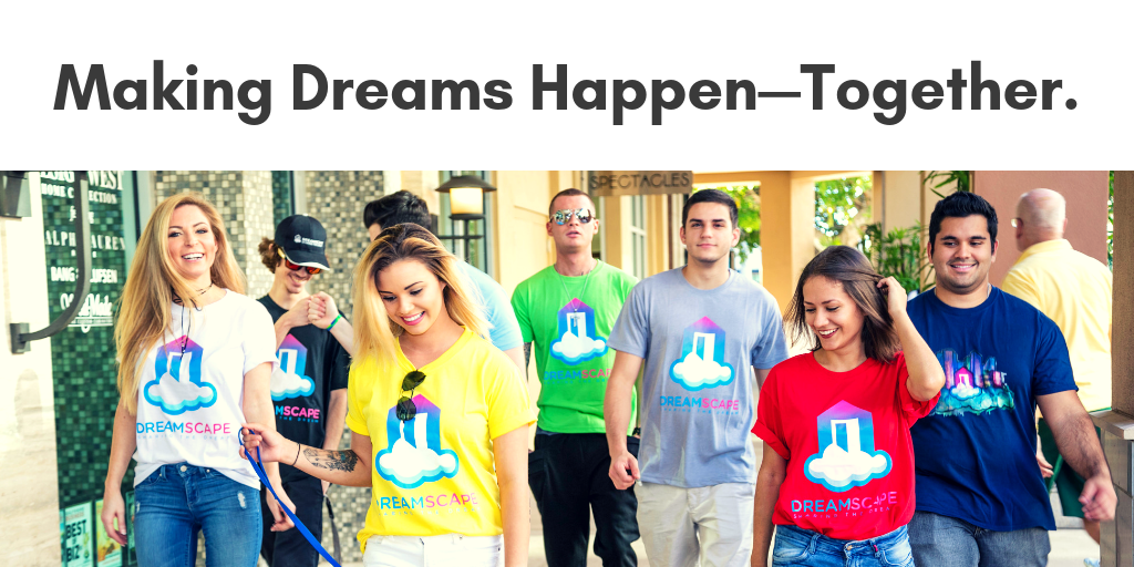 A colorful image of Dreamscape Foundation staff and volunteers walk through an outdoor mall wearing t-shirts representing this charity for the blind.