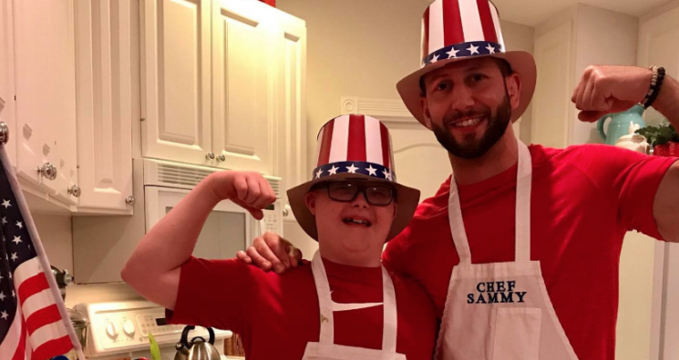 An image of Parker and Sammy together in patriotic clothing and cooking aprons. Sammy advocates alongside Parker for disability awareness and is volunteering for the SWFL Night to Shine event.