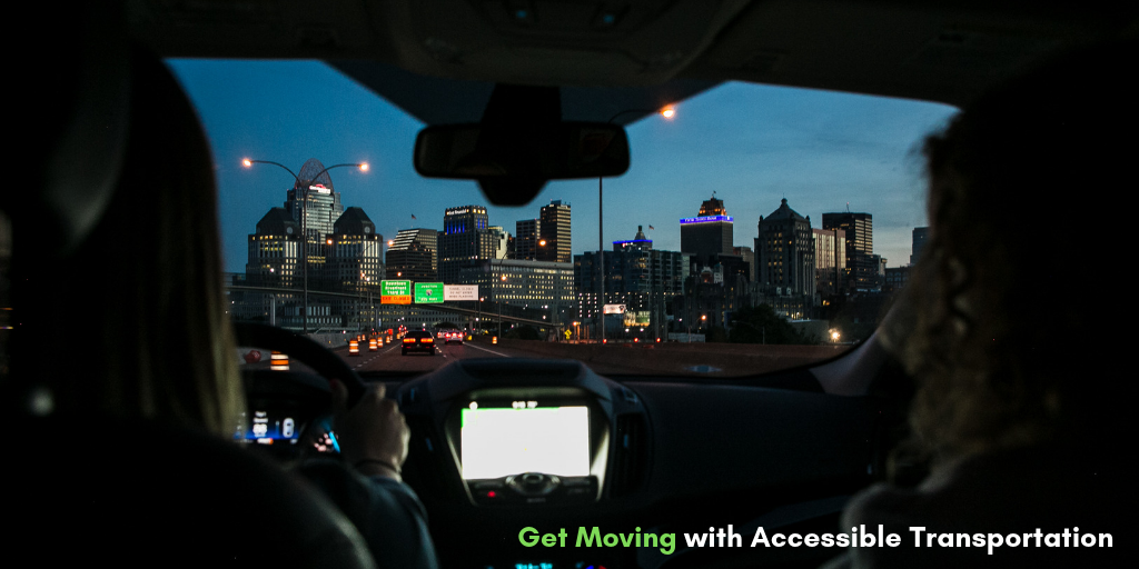 An image of two individuals in a car driving down the highway at night is coupled with the phrase, 'Get moving with accessible transportation.' It illustrates the subject of Dreamscape Foundation's blog on how to find local accessible transportation.
